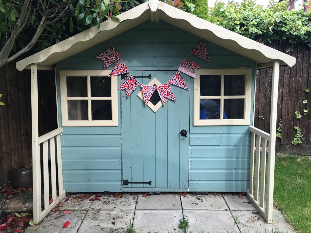 Union flag bunting hanging on a shed