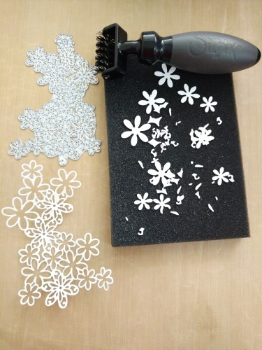 Step 7- Remove the excess paper cut outs with the help of Sizzix die brush tool and foam pad, to get a clean cut.