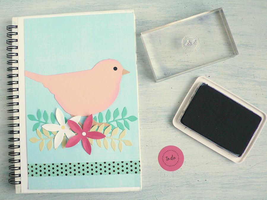 Create an altered notebook with little bird