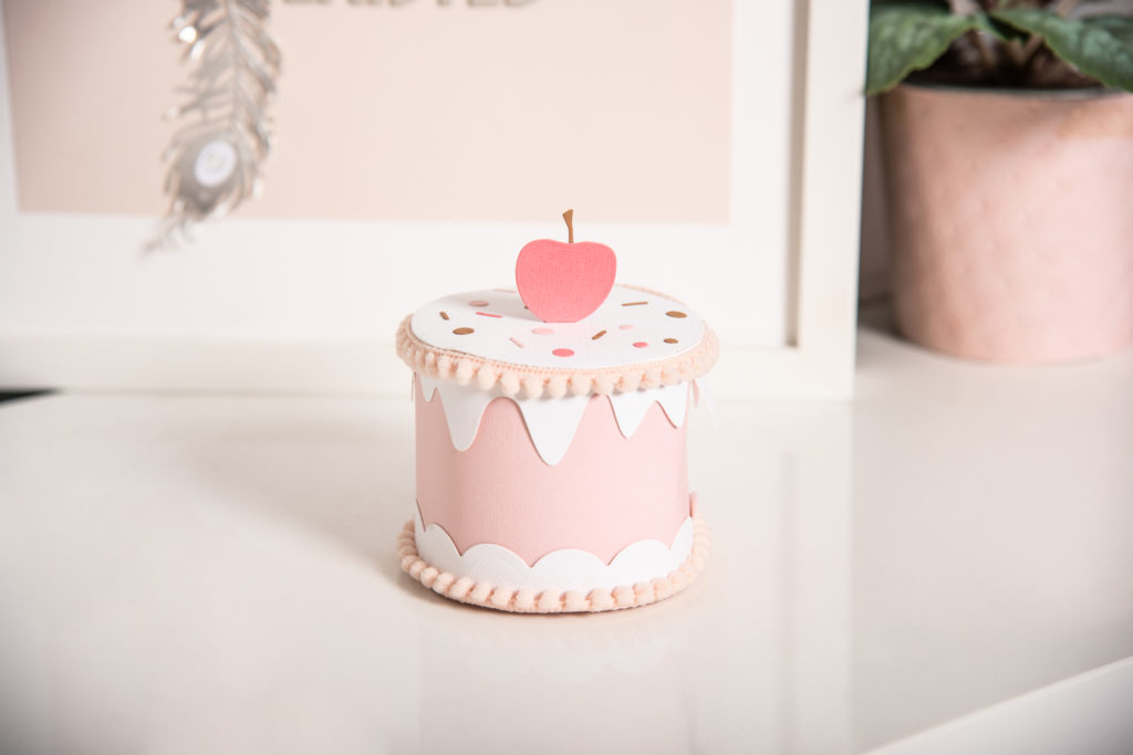 A cake sitting on a table  Description automatically generated