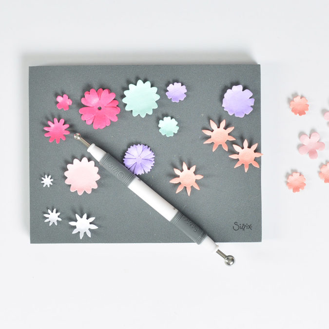 Use the Paper Sculpting Tool and Sizzix Craft Adhesive to adhere the flowers together.